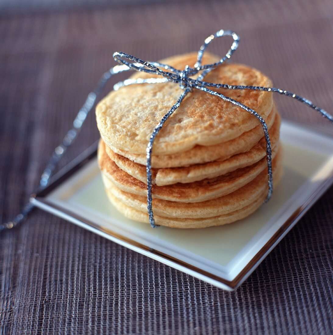 Stacked blinis tied with ribbon