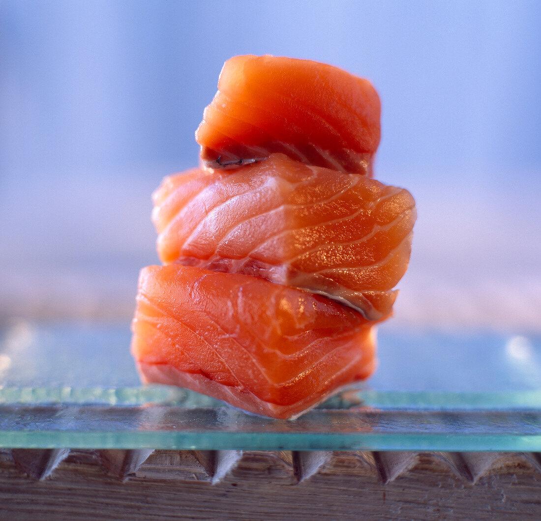 Cubed raw salmon