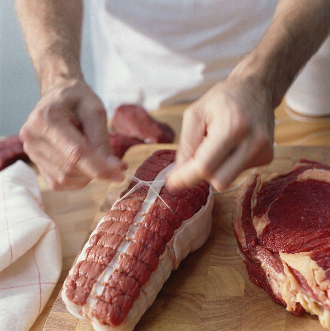 Tying up roast beef