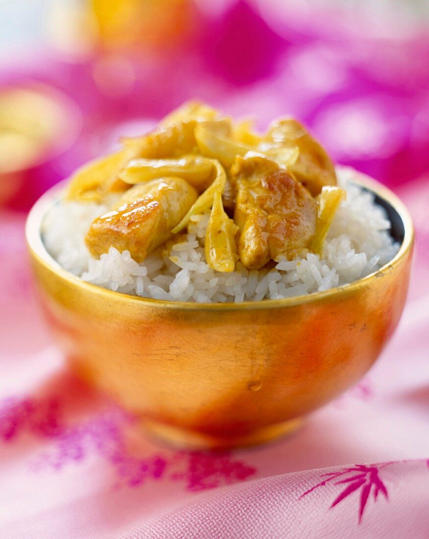 bowl of rice and sautéed curried chicken