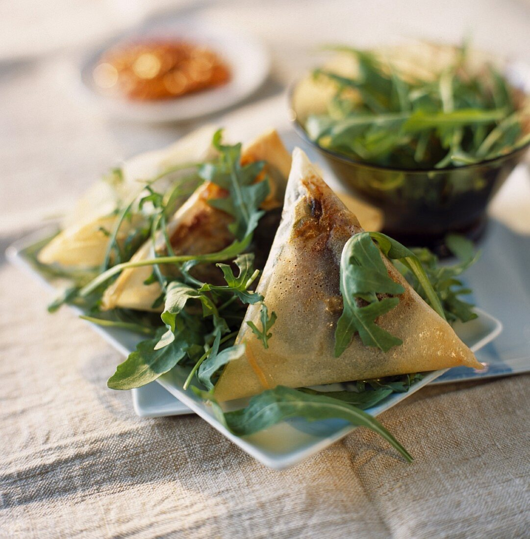 Crunchy smoked fillet of duck filo parcels with prunes