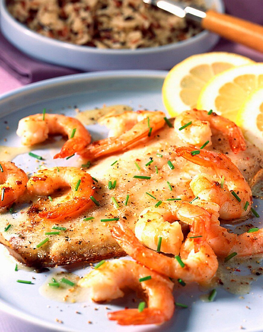 Oven-baked sole and prawns with butter