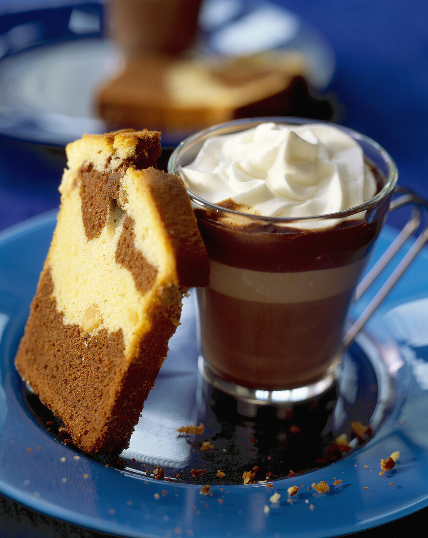 Chocolate Viennese dessert with slice of marble cake