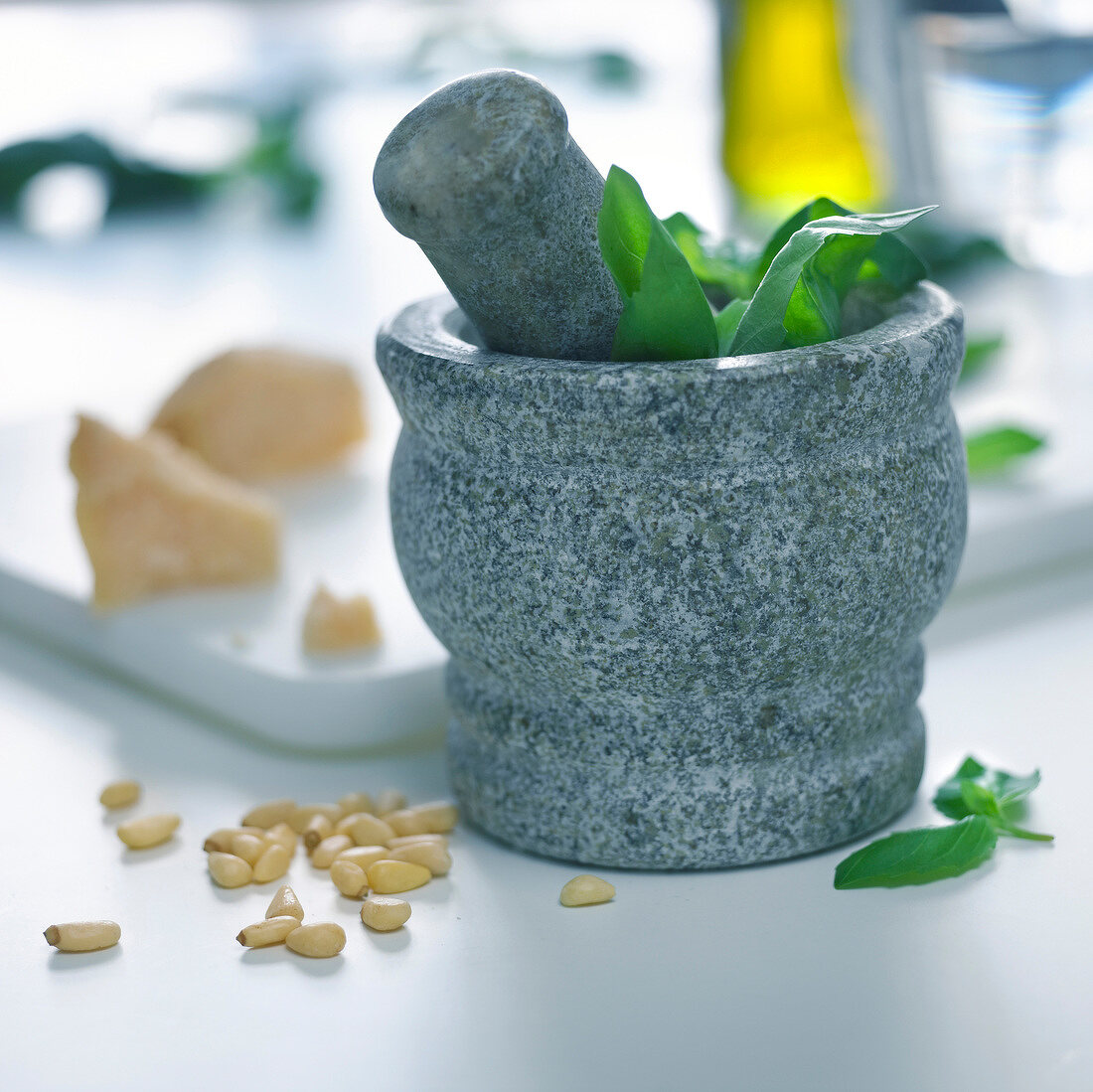 Preparing pesto sauce with pestle and mortar