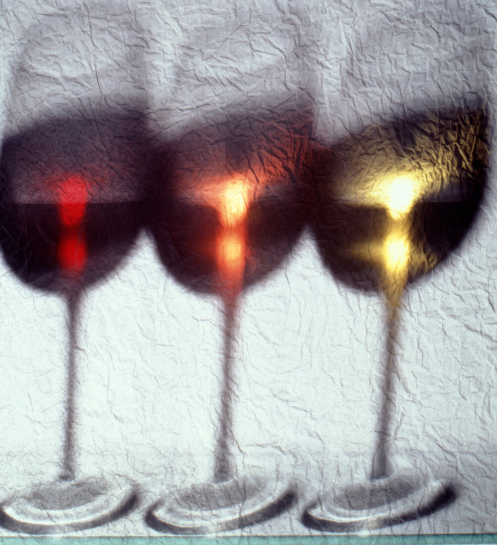 Out of focus glasses of wine