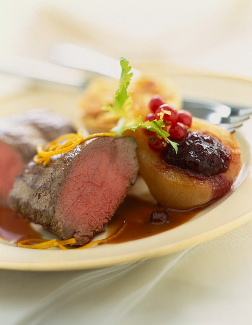 Thick beef steak with poached pear