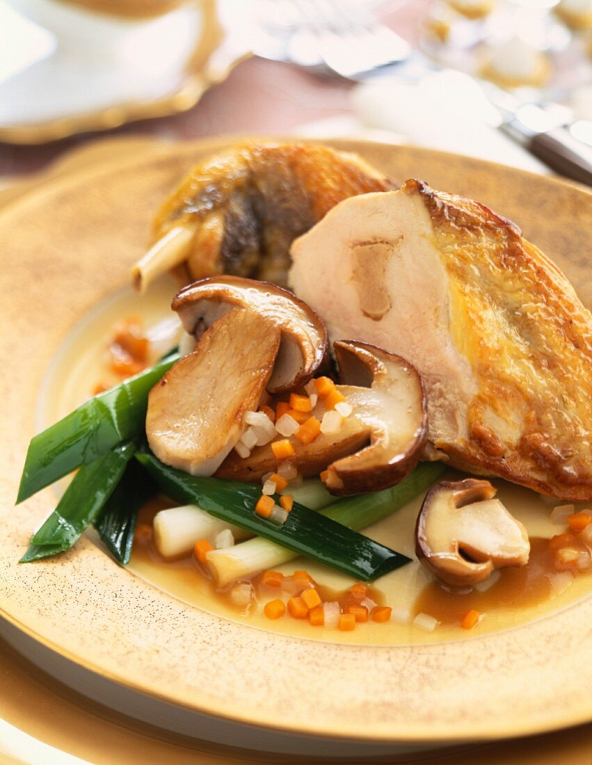Guinea-fowl with foie gras,ceps and vegetables