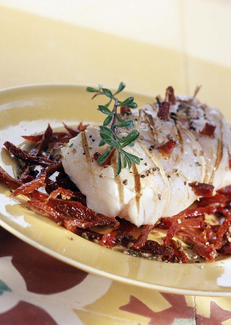 cod roast studded with chorizo and tomato confit