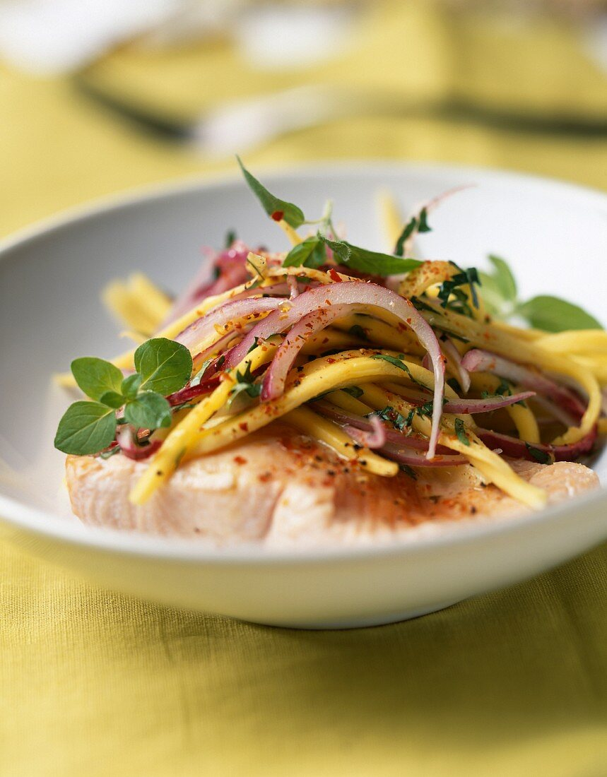 Salmon steak with chinese noodles and red onion