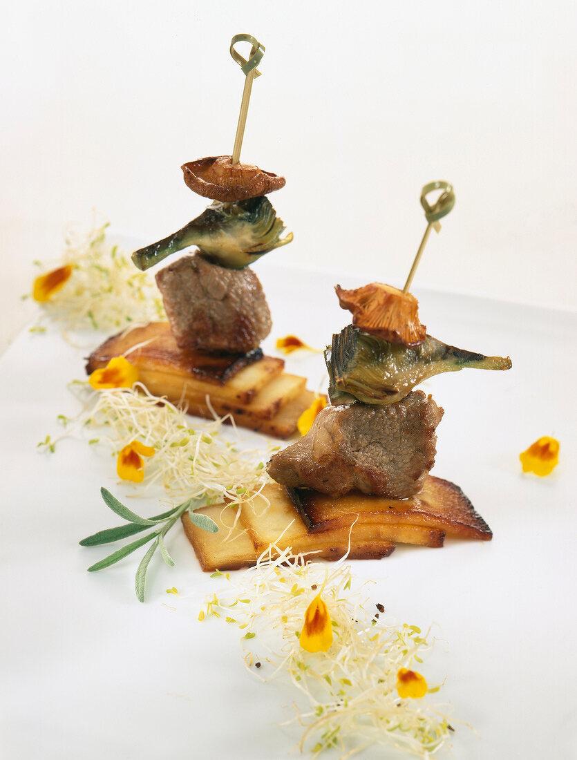 Lamb, artichoke and mushroom brochettes