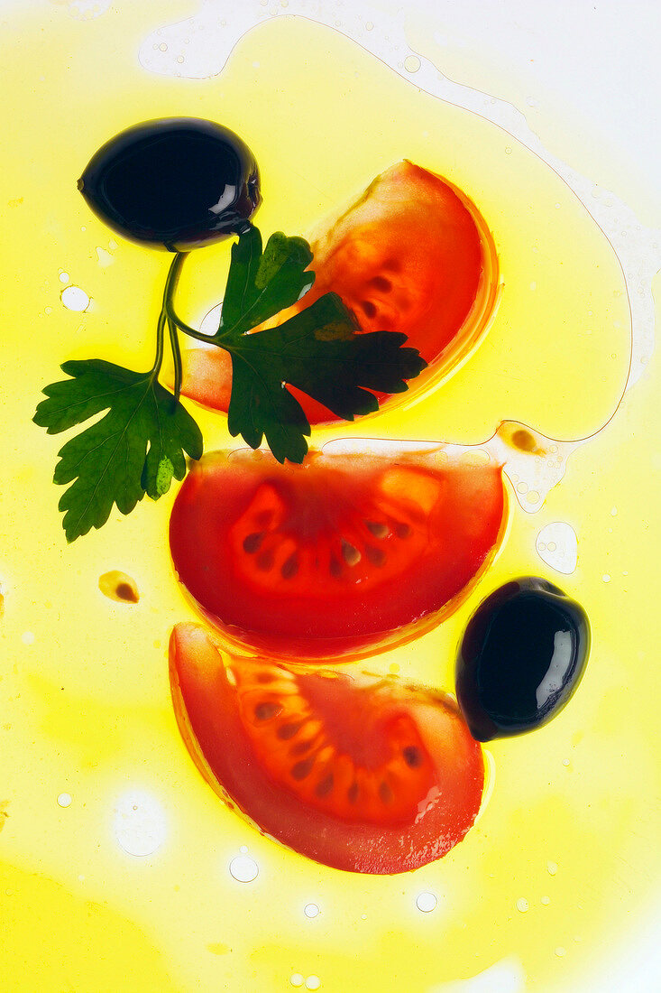 sliced tomato, black olives and parsley in oil
