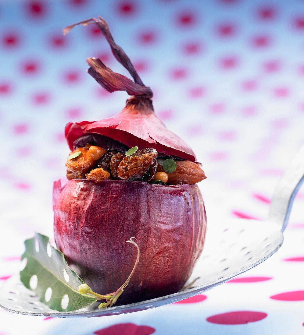 Red onion stuffed with almonds,grapes and honey