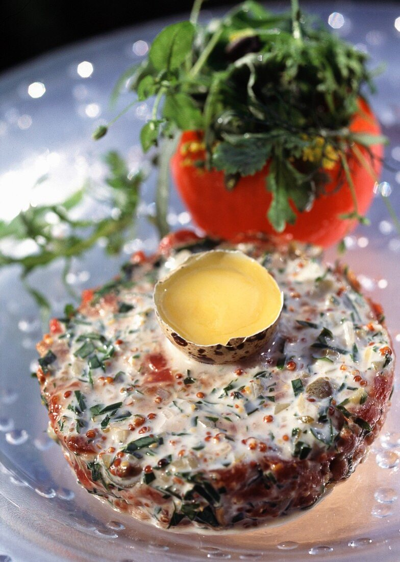 Beef fillet tatar with herbs and quail's eggs