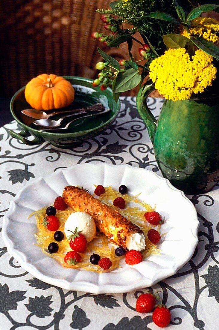 Cannoli (fried Sicilian pastry rolls) with goat's cream cheese, lemon zest, honey ice cream and fresh berries