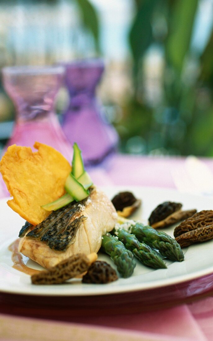 Bass with asparagus and morels