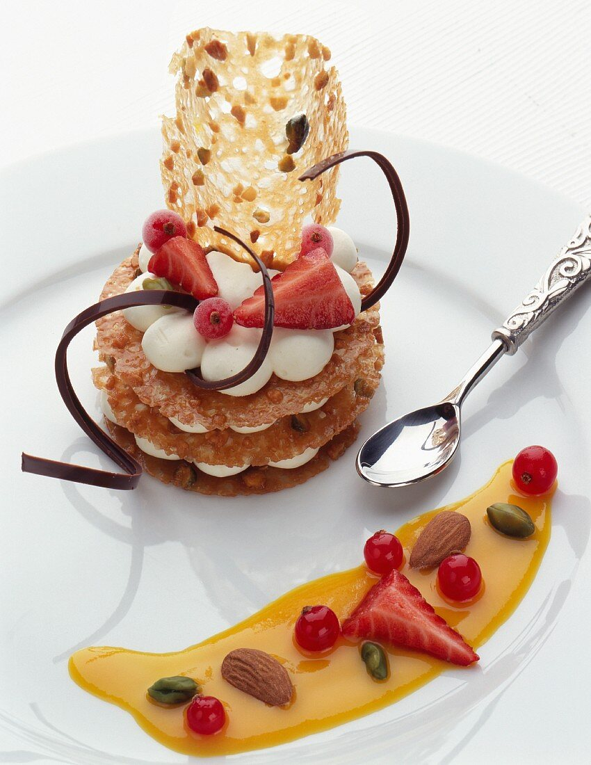 Crunchy tuile biscuit ,cream and summer fruit Mille-feuille ,passion fruit puree