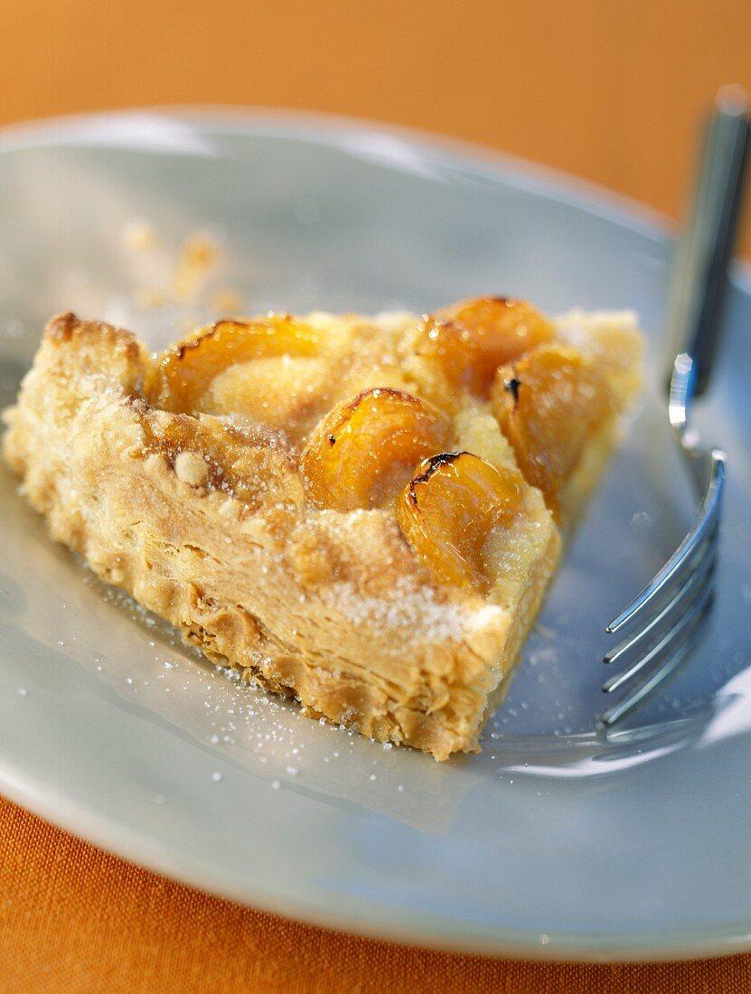 Slice of flaky pastry pie