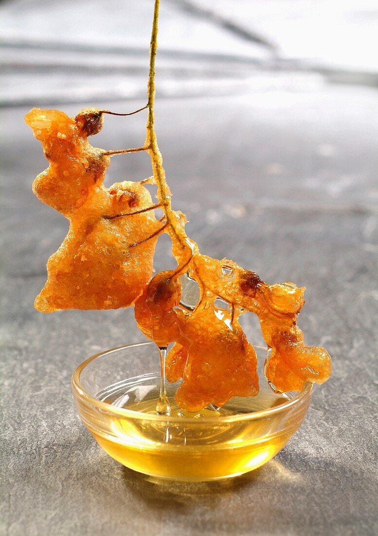 Acacia beignets with honey