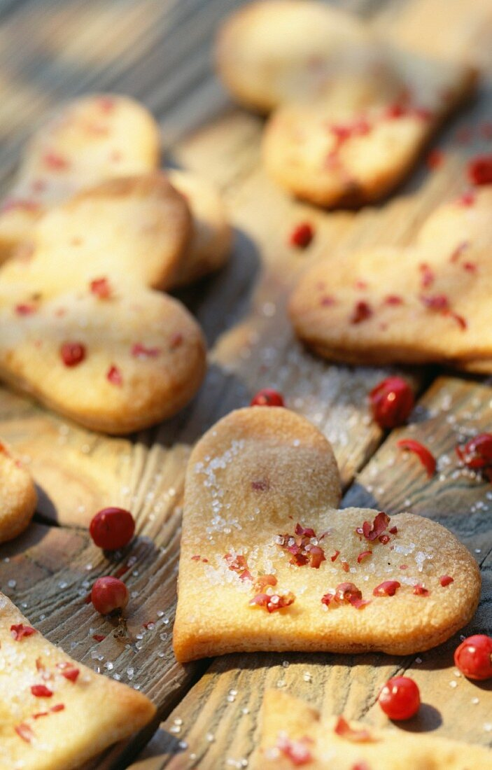 Heart-shaped shortbread biscuits with pink peppercorns