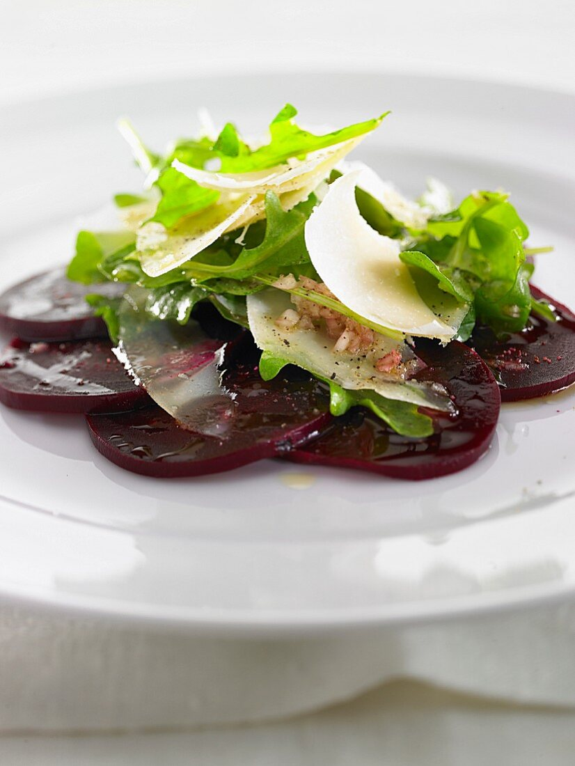 A beetroot rosette with rocket and Parmesan cheese