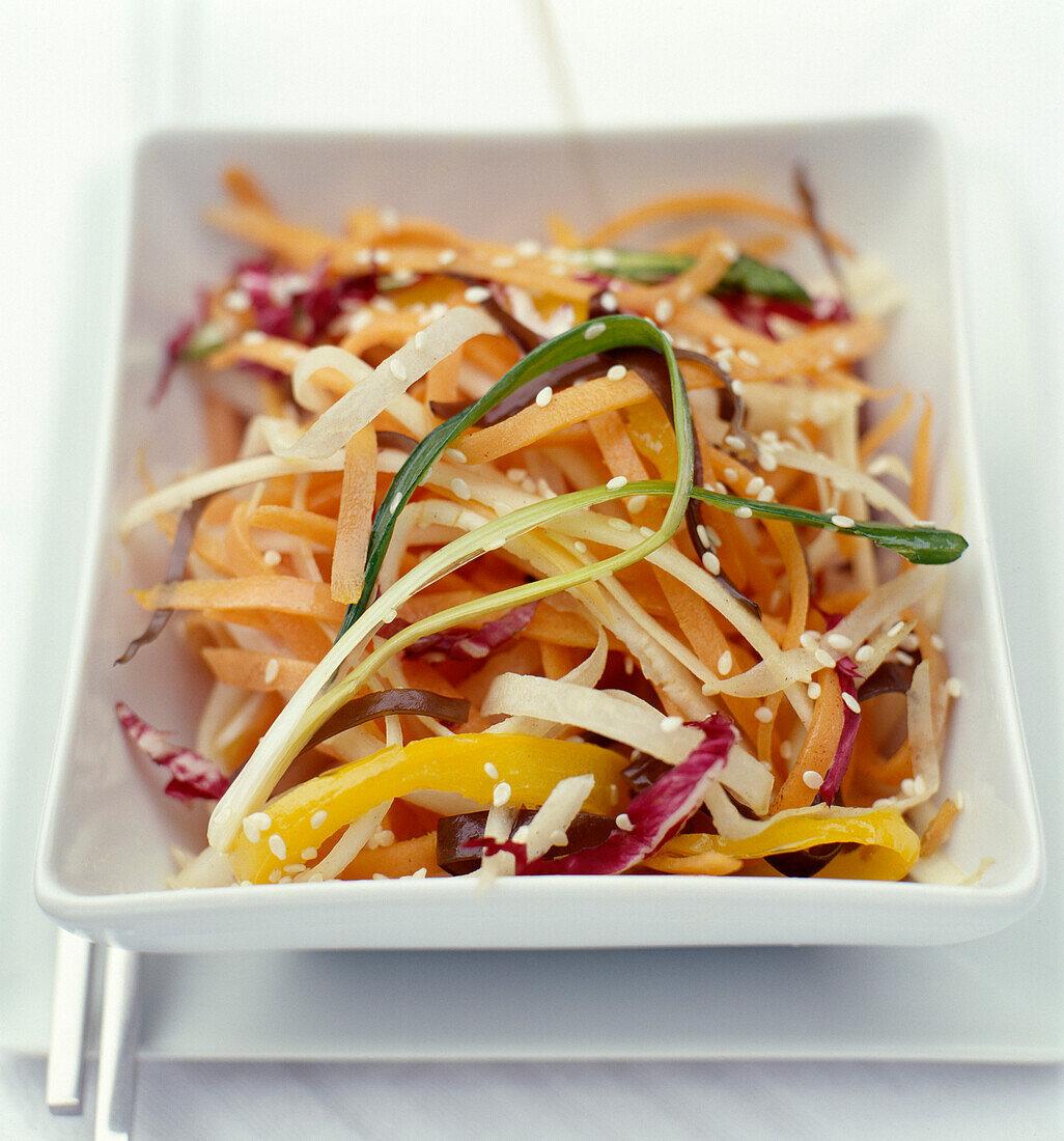 Crisp vegetable salad with sesame seeds