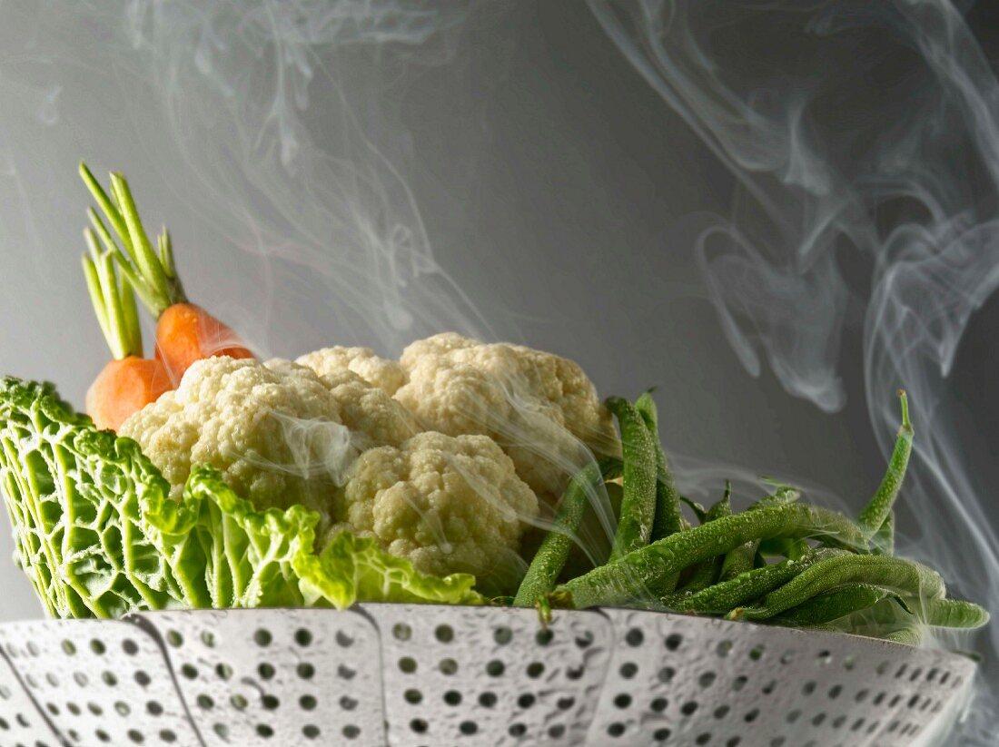 Steam cooking vegetables