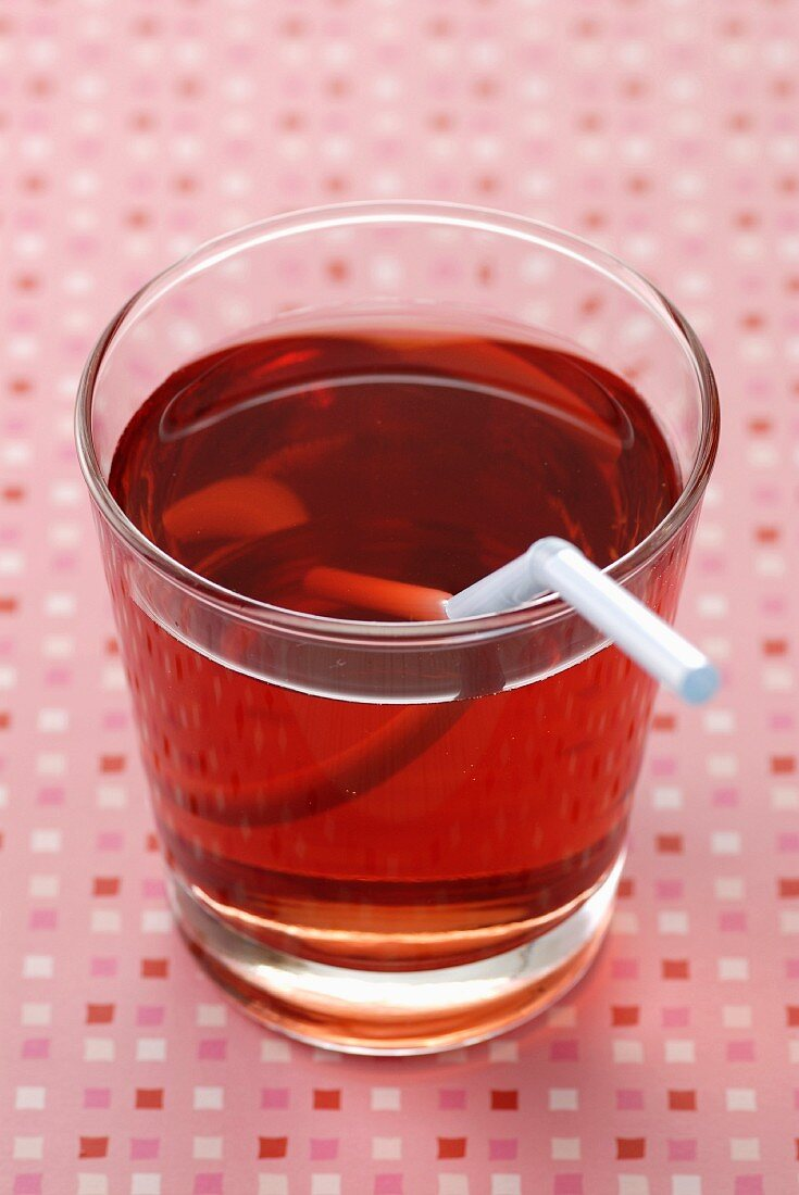 Glass of strawberry syrup