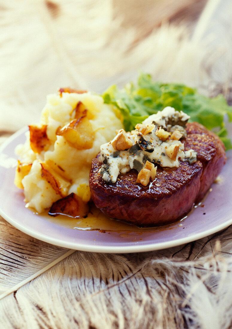Thick ostrich steak with roquefort and walnut sauce
