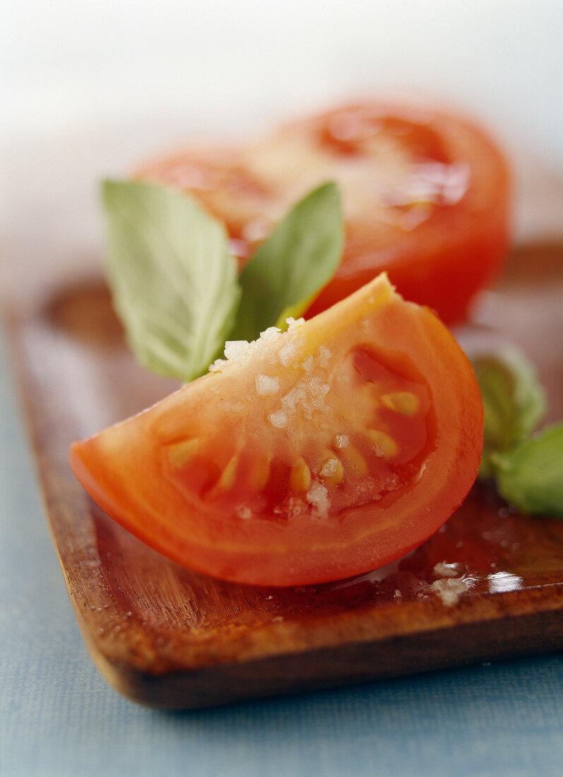 Cherry tomatoes cut in quarters ,basil and coarse salt