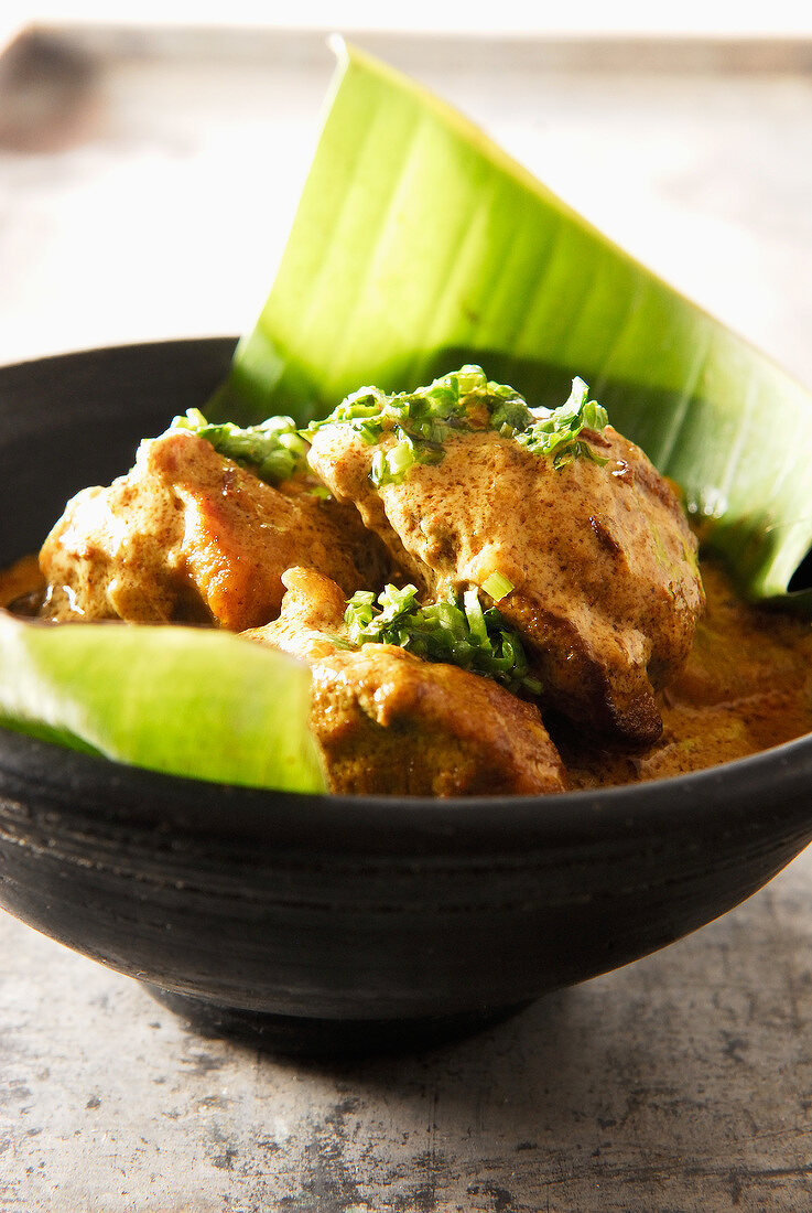 Lamb curry served in a banana leaf