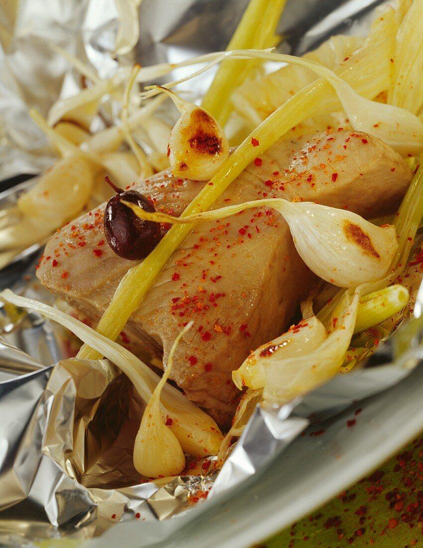 Tuna and confit garlic cooked in aluminium foil
