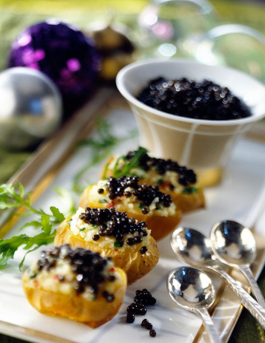 Potato garnished with caviar