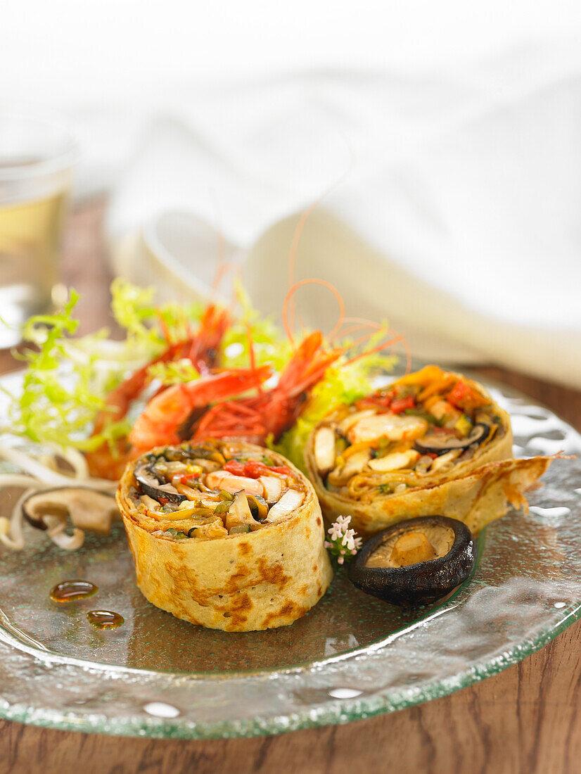 Pancake rolls filled with sautéed vegetables