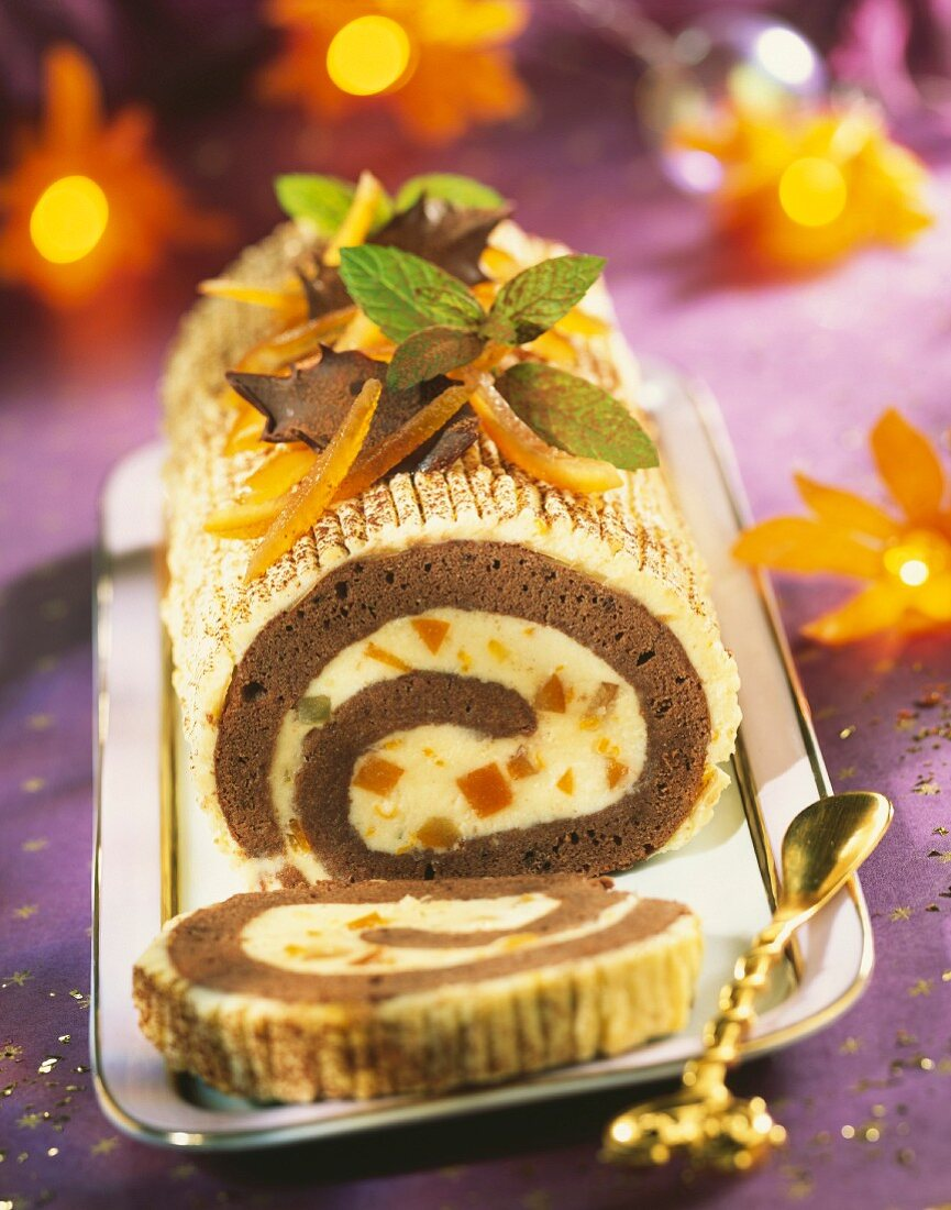 Two chocolate and orange rolled log cake