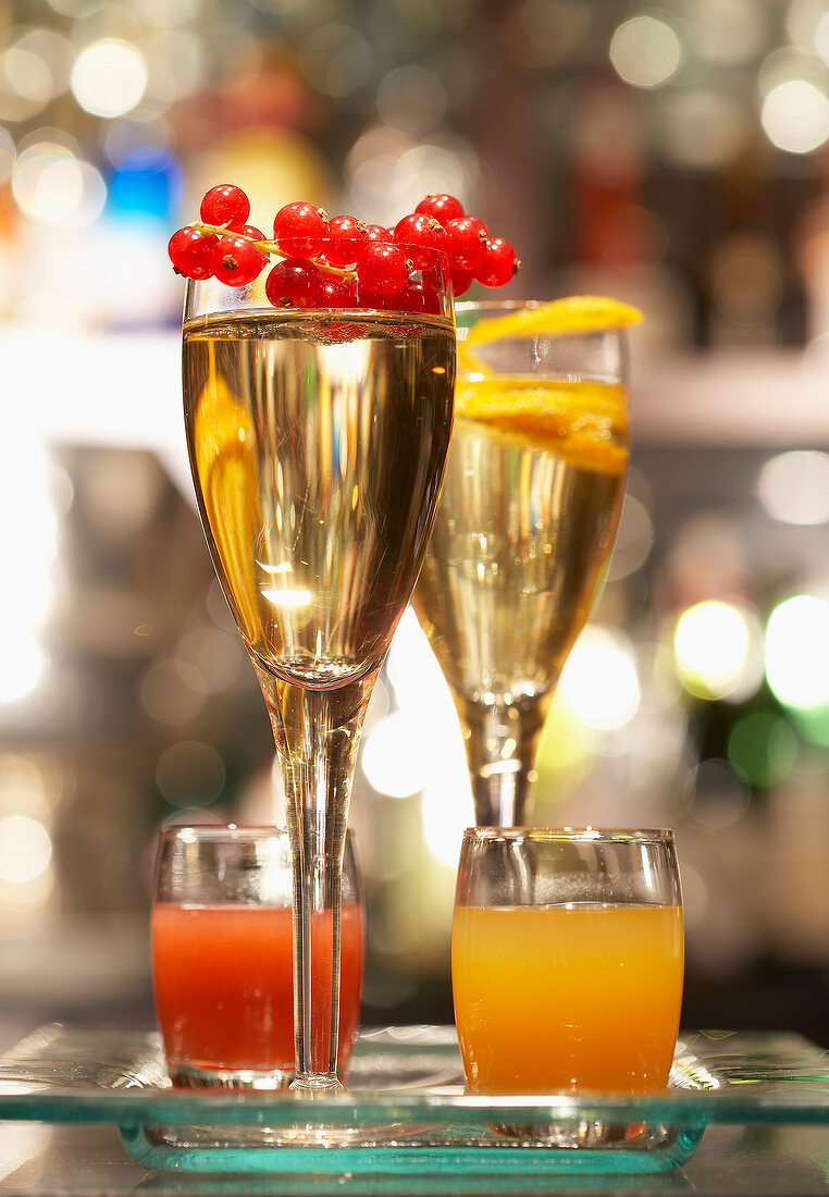 Glasses of Champagne and redcurrant and orange cocktail