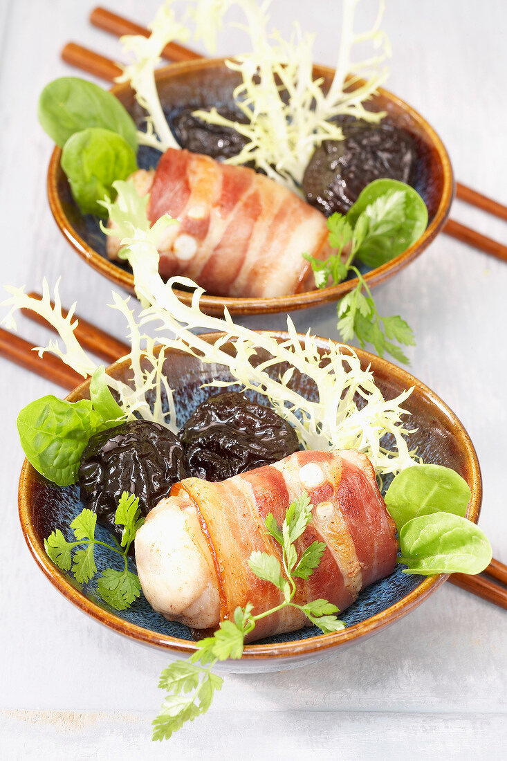 Rabbit wrapped in bacon with prunes