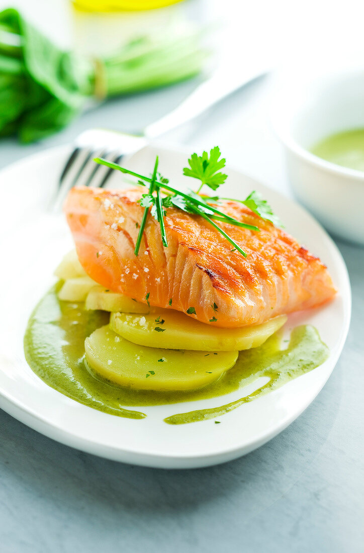 Thick piece of salmon grilled on one side with sorrel sauce