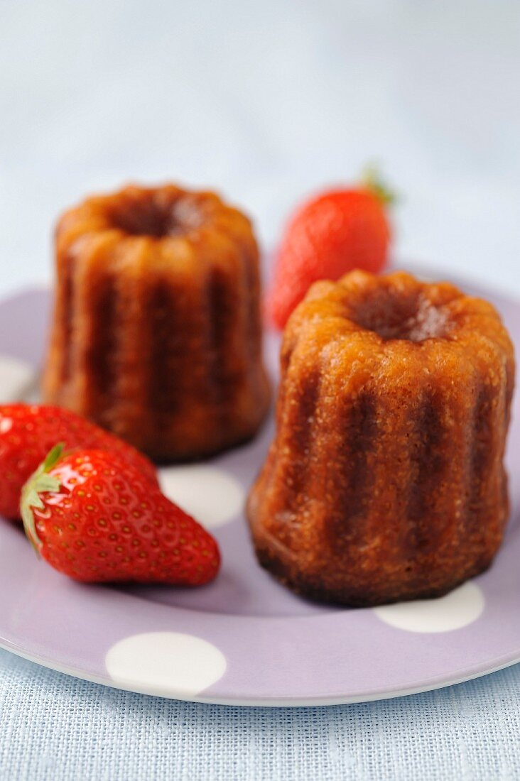 Cannelés and strawberries