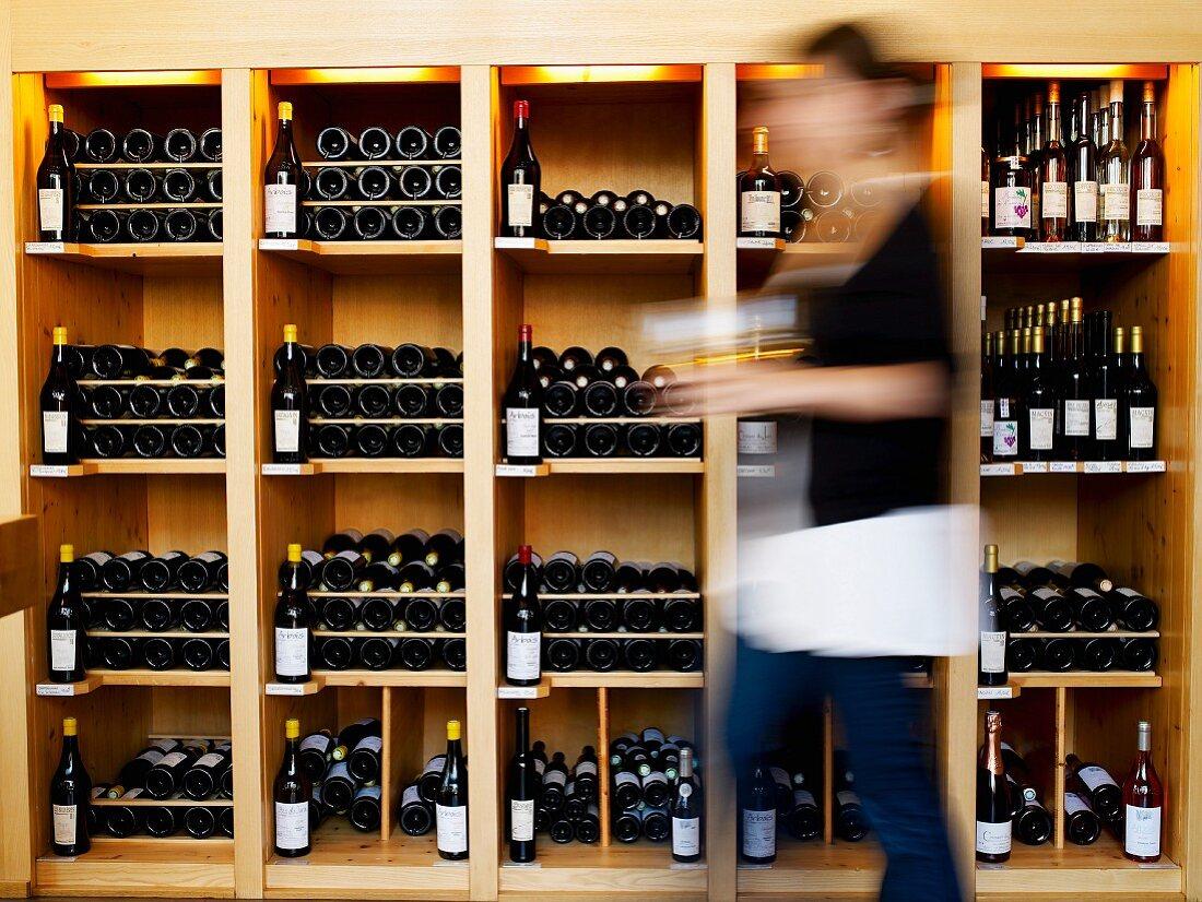 Bottles of wine on the shelves at the wine merchant