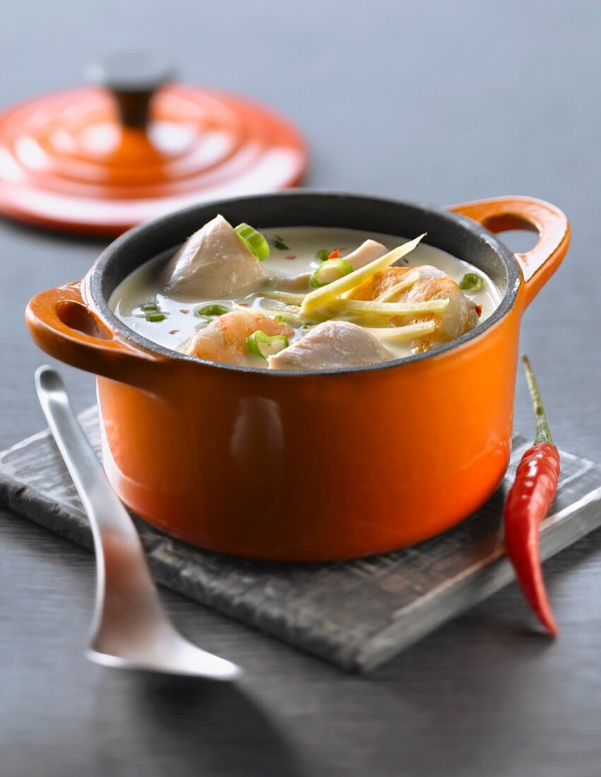 Small casserole dish of spicy chicken and shrimp Thai soup