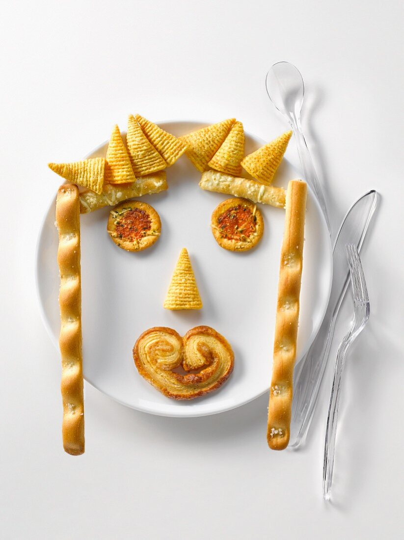 Plate of appetizers in the shape of a face