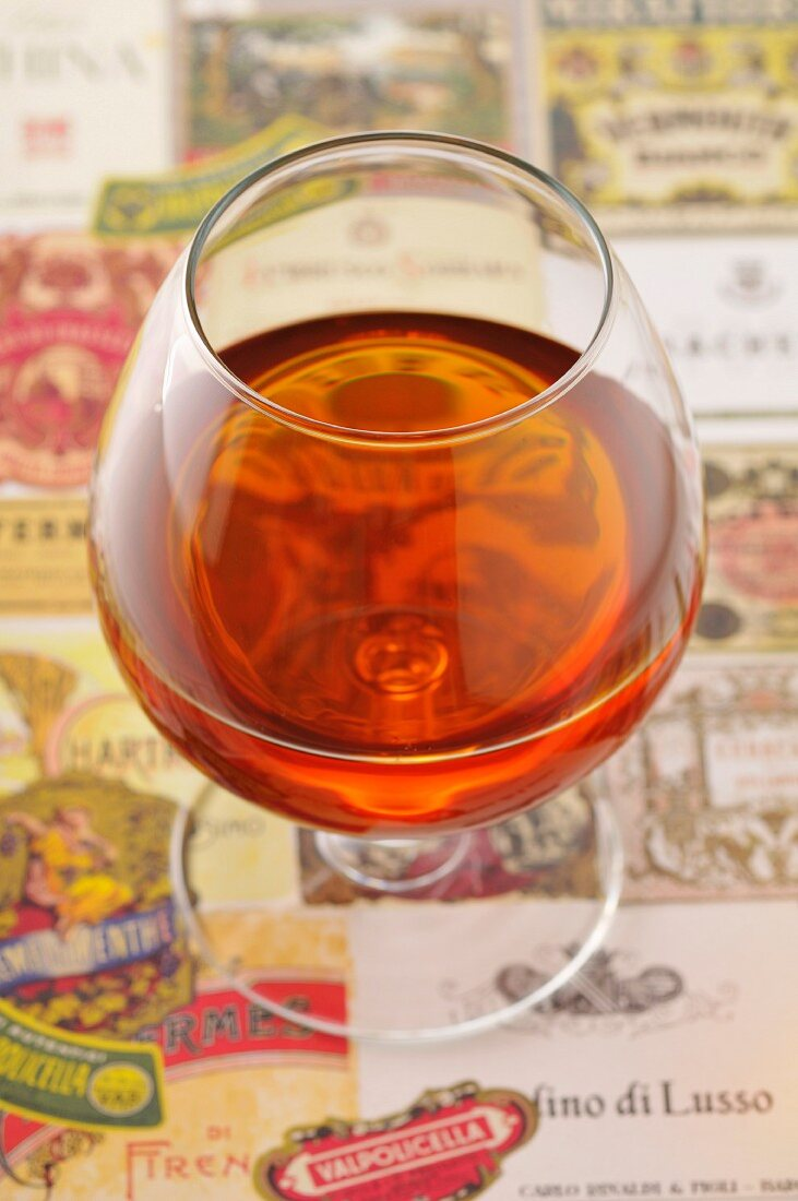 Glass of Cognac and labels
