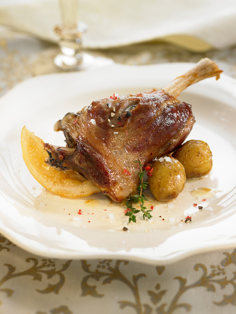 Oven-baked shoulder of lamb