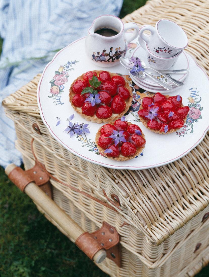 Strawberry tartlets on a picnic basket