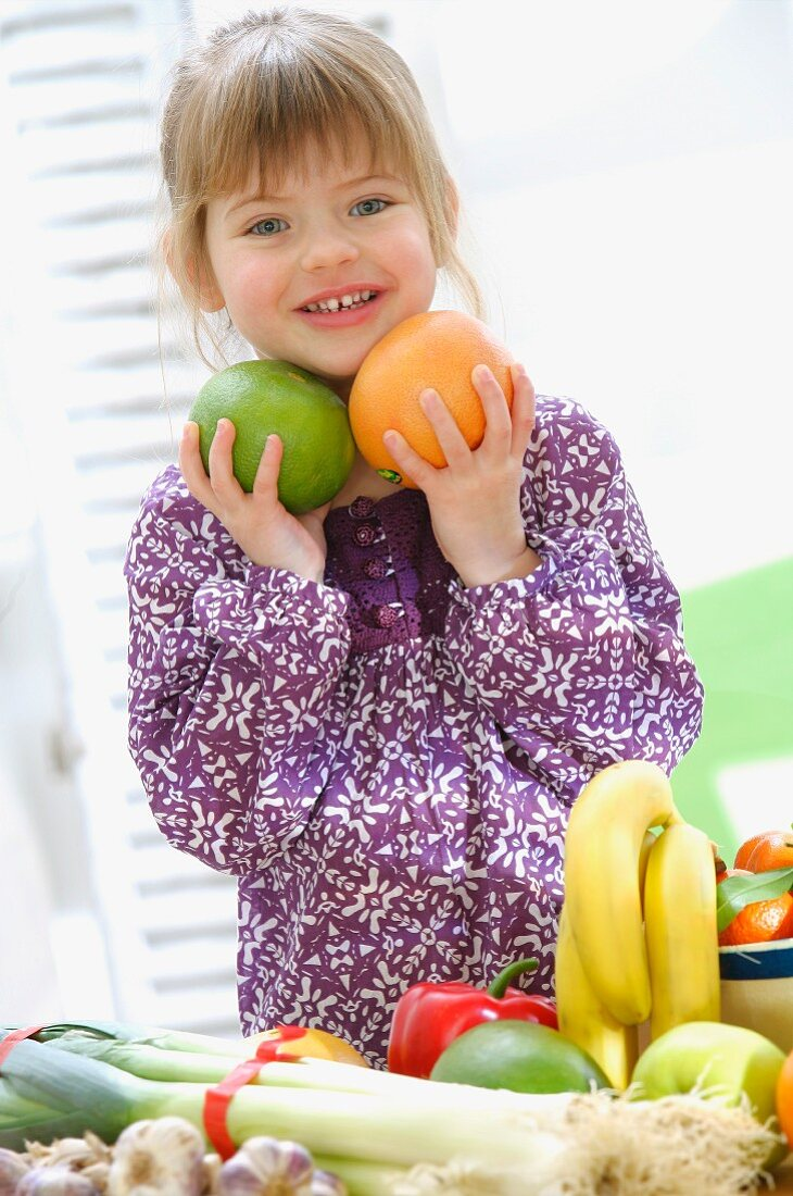 Young girl carrying fruit