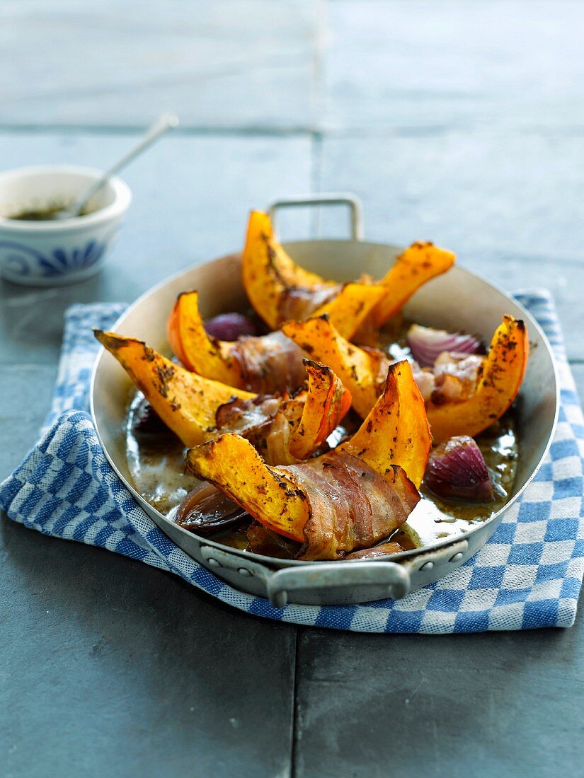 Slices of squash roast with bacon and beer