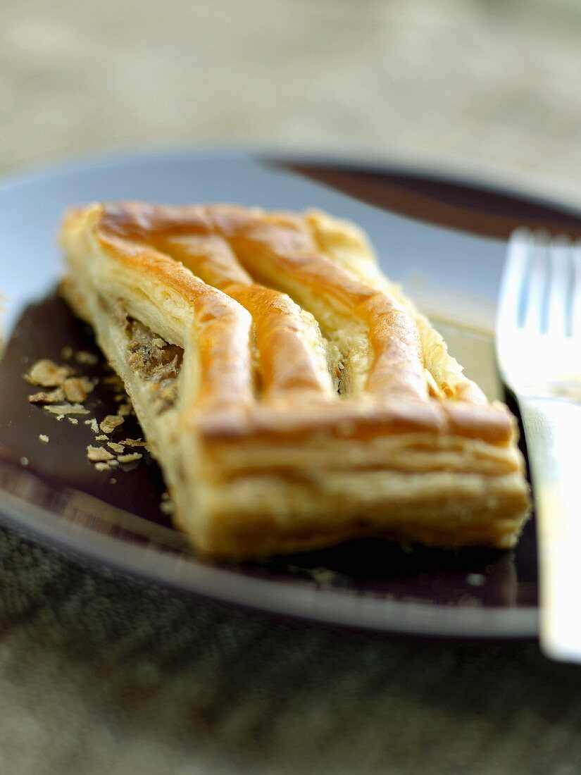Portion of dried fruit flaky pastry pie