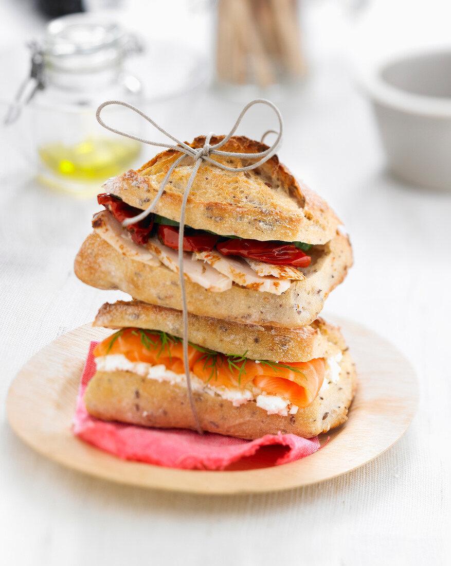 Smoked salmon small bread sandwich and turkey breast small bread sandwich