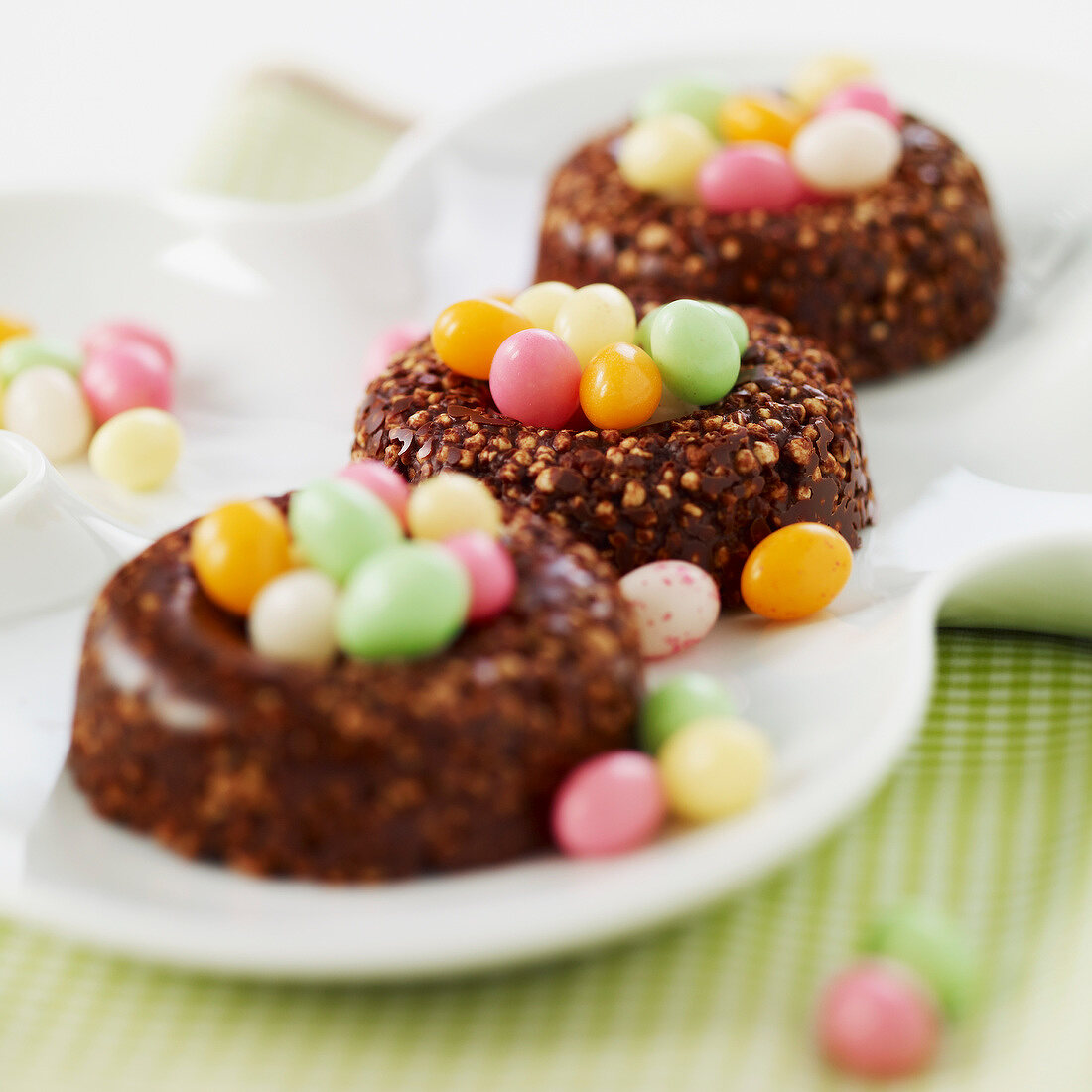 Crunchy chocolate nests filled with multicolored sugar Easter eggs