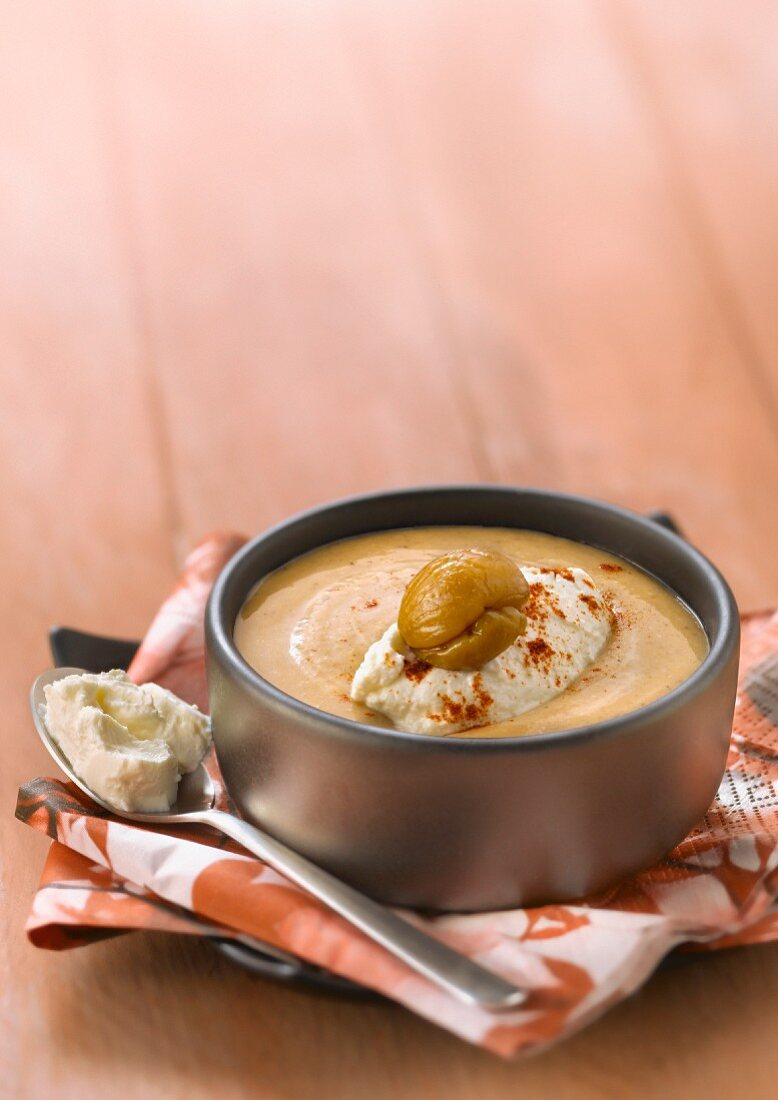 Cream of chestnut soup with a ricotta quenelle and paprika